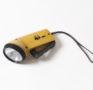 Gelbe Taschenlampe mit handbetriebenem Dynamo, um 1970